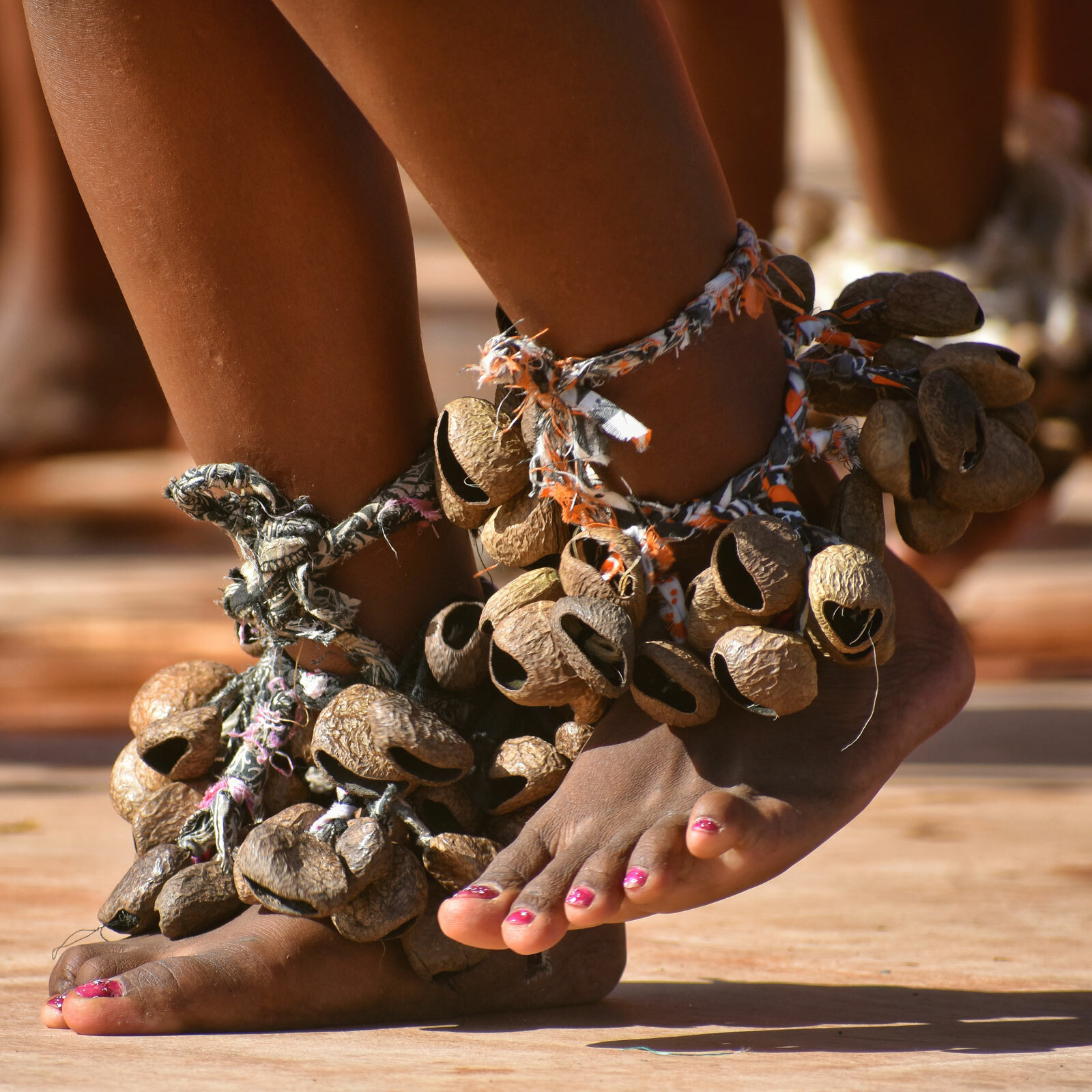 Feet adorned with decorations while dancing
