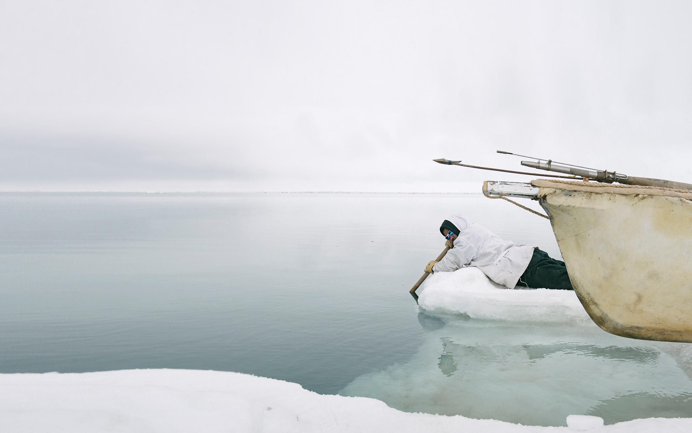 Fisherman on ice near water