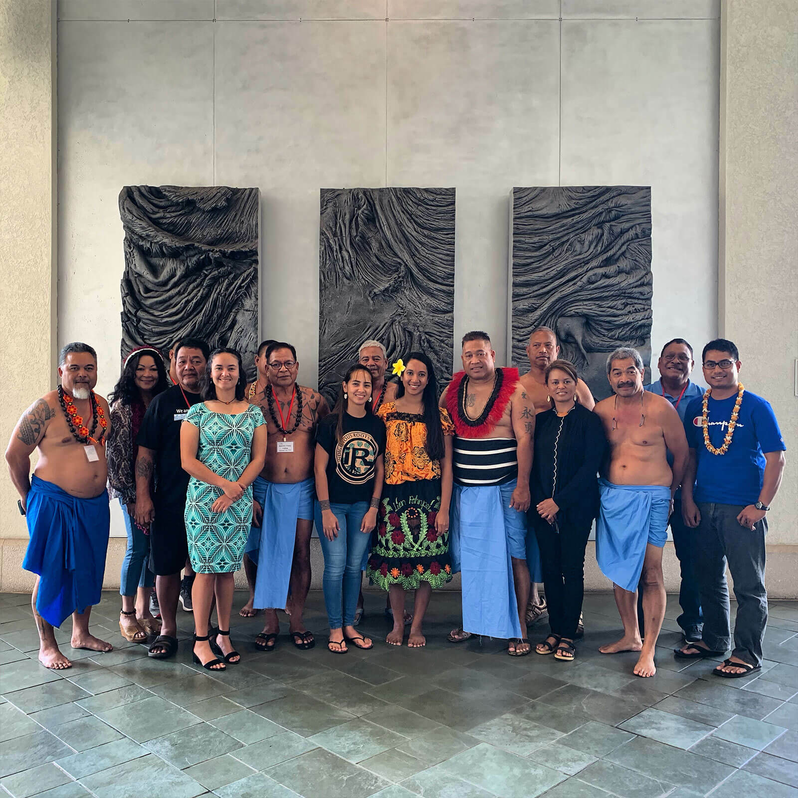 Group of people in front of artwork