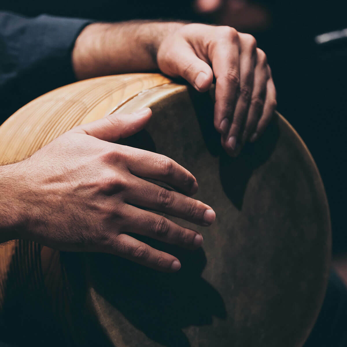 Hands playing drum