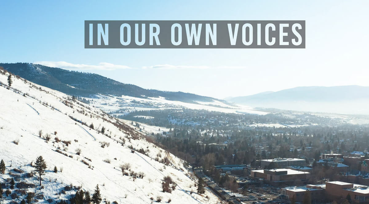 """Snow covered mountains and trees with the words """" In our own voices"""" printed across the top"""