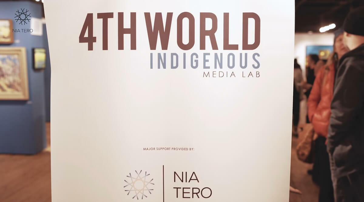 Standing banner that reads 4th World Indigenous Media Lab with Nia Tero logo underneath