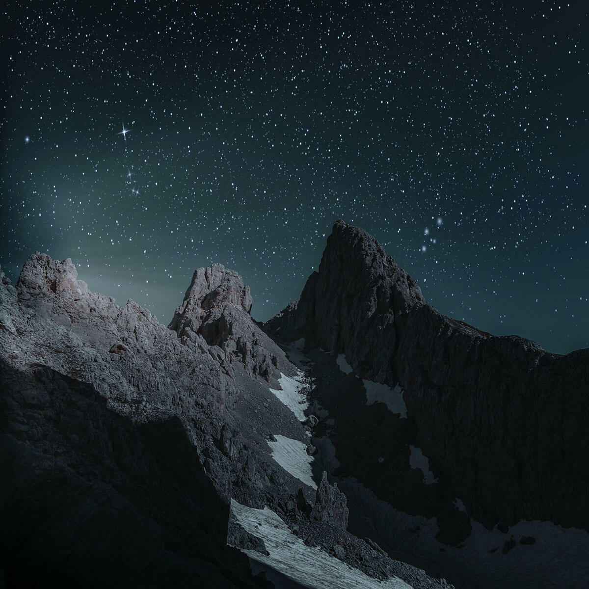 Mountains in front of starry sky