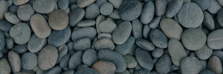 multiple flat gray rocks