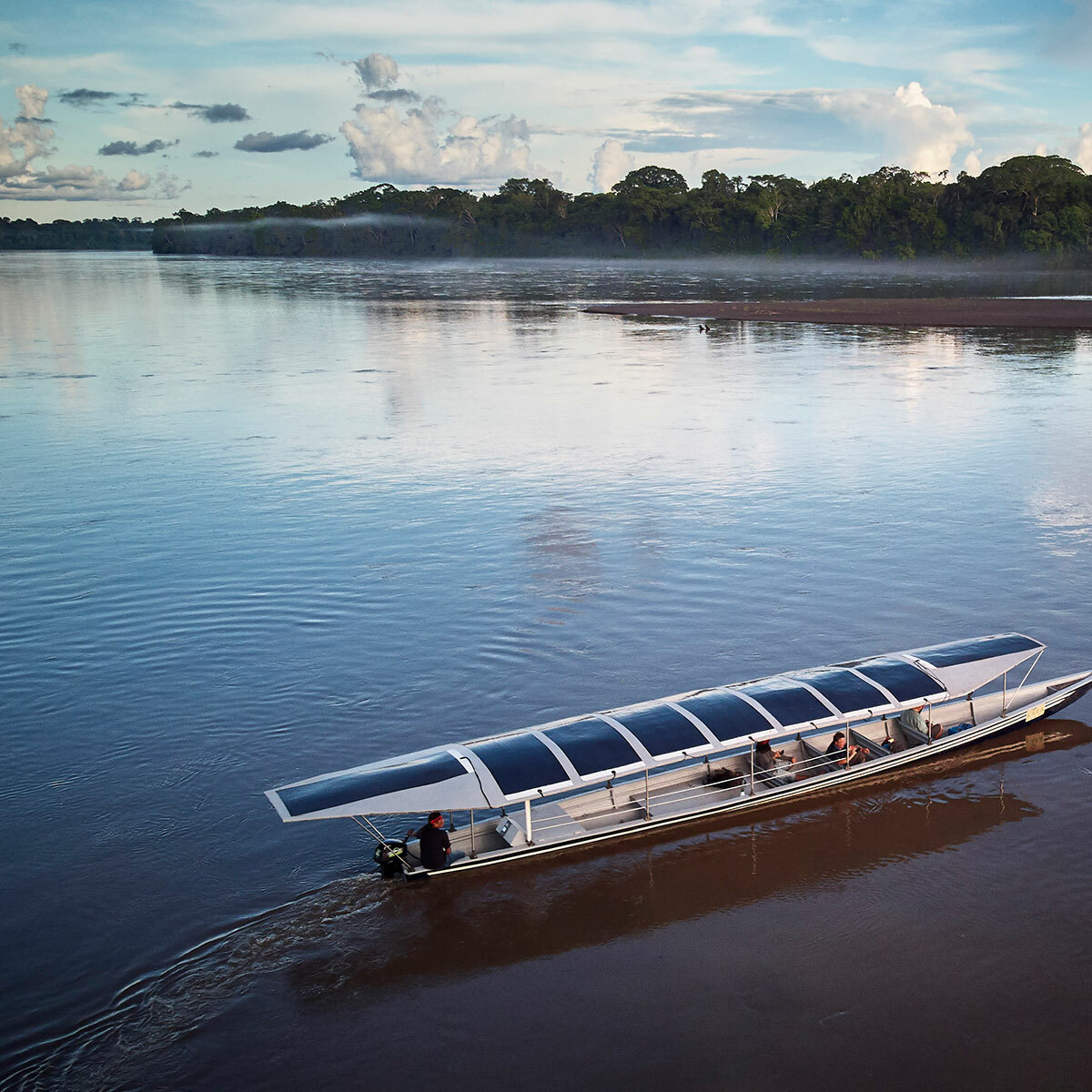 Solar powered boat on water