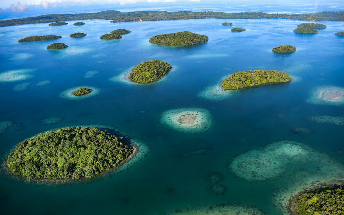 Drone/sky view of coastal waters with islands scattered throughout