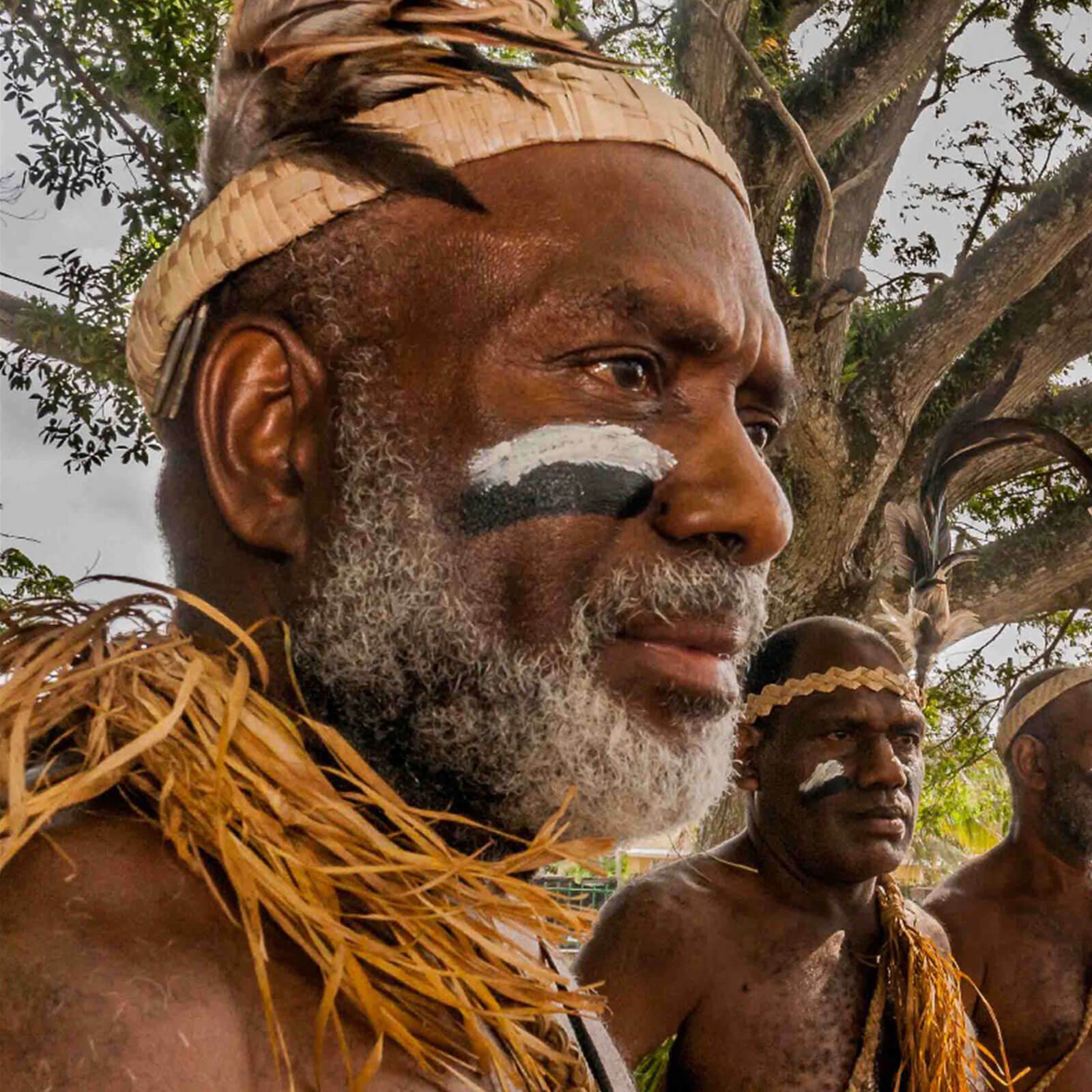 Tribal men staring into distance